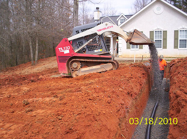 Installation of top aggregate layer Northeast Georgia based GSI offers septic system installation, maintanance and repair