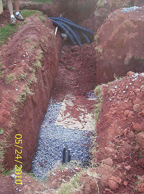 Overview of single drainfield trench Conventional Gravel System maintenance install repair company GSI is a your full service septic tank provider
