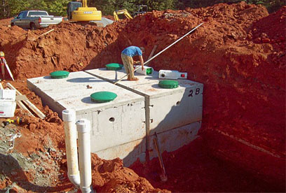 Project manager, Heath Kilgore, installing commercial filters GSI provides full service septic tank repair and septic system maintenance