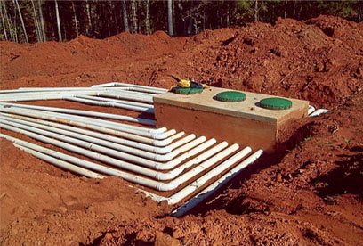 28 hole distribution box with lateral lines (left angle view) GSI provides full service septic tank repair and septic system maintenance