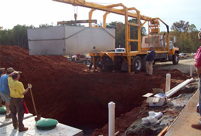 Nix Tank Company setting lower portion of 3000 gallon tank GSI provides full service septic tank repair and septic system maintenance