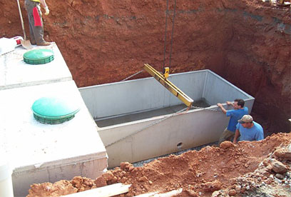 leveling lower portion of 3000 gallon tank GSI provides full service septic tank repair and septic system maintenance