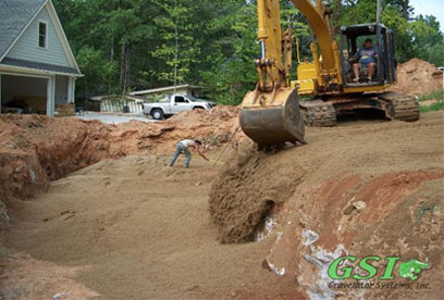 placing ASTM C-33 sand in bed area GSI is your source for septic system repair in Northeast Georgia