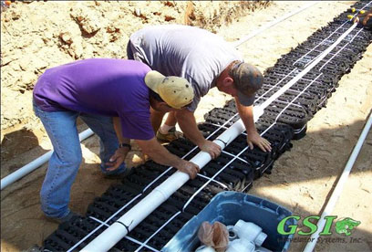 installing orifice distribution assemblies GSI is your source for septic system repair in Northeast Georgia